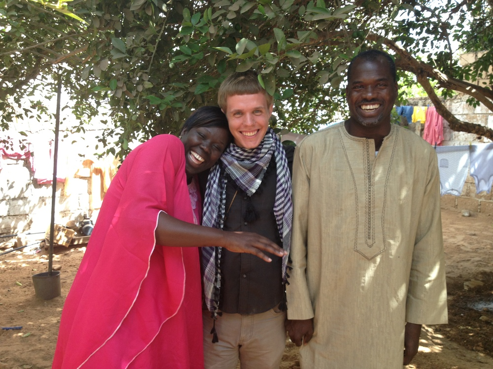 Jordan with his host mom and dad in Senegal. (Photo: Jordan Ricker)