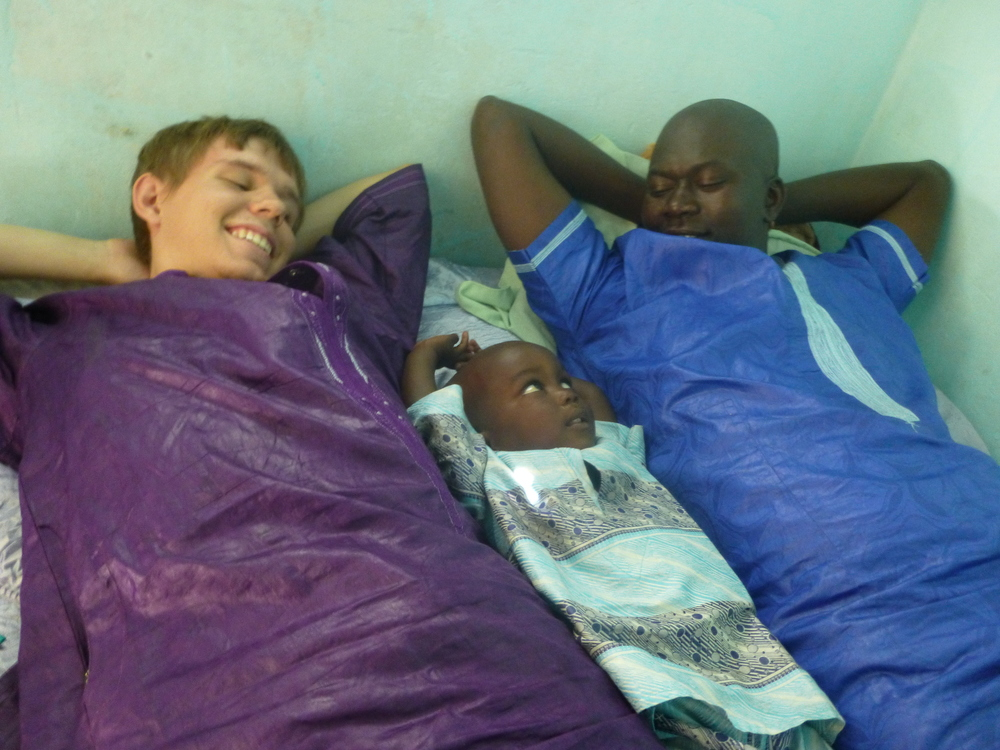Jordan hanging out with two friends at a wedding in Senegal. (Photo: Jordan Ricker)
