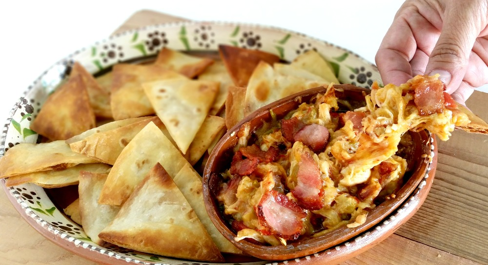 Green Chiles, Tomatoes, Shredded Chicken, Diced Bacon and Cheese. Eaten with homemade tortilla chips.