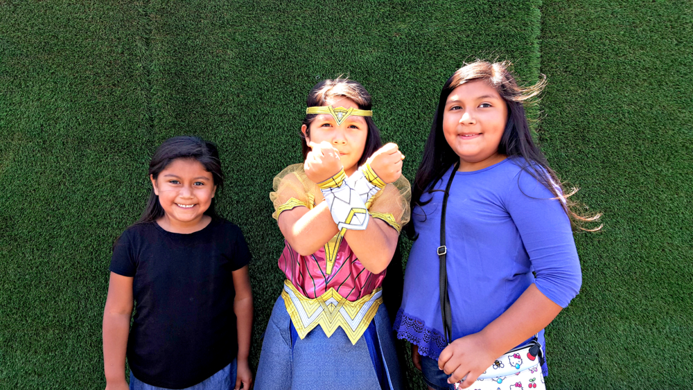 My girls pictured here with my friend  Cleverly Catheryn's  little Wonder Woman.
