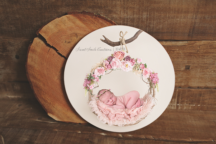 Wood Photo Block circle with Newborn Baby girl in Bum up pose hanging on floral wreath. www.sweetsmilecreations.com