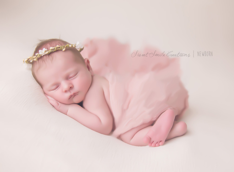 Oil Painting Canvas of a newborn baby girl with a floral crown and draping pink wrap on.