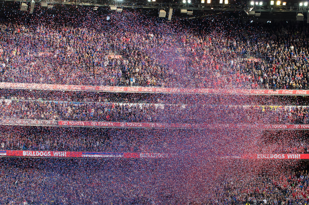 A few seconds after the streamers were released, the crowd and players are lost in colour.