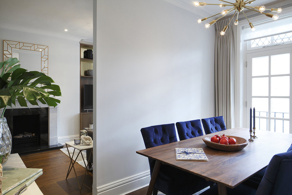 NW1 - Dining room - displaying the dining table and part of fireplace in living room.jpg