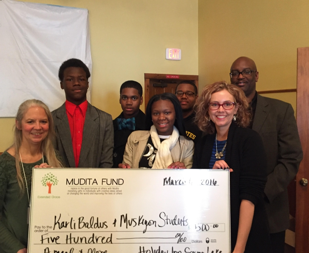 (L-R) Barbara Lee Van Horssen, Extended Grace experi-mentor and executive director; Tyrique Chalk; Armontae Hendricks-Johnson; Charity McClanahan; Keyshawn Crowley; Karli Baldus; Bernard Loudermill, Muskegon High School dean of students.