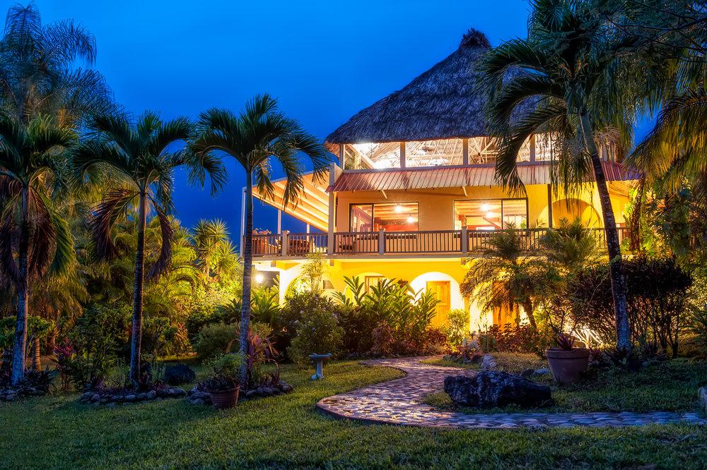 Photo of main villa and The Grove House restaurant via Viva Belize.