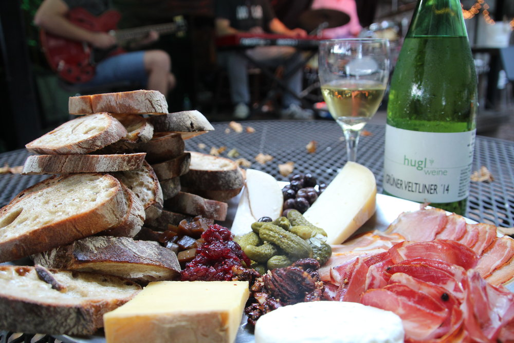 A beautiful charcuterie board from Bacchanal which has  live music 7 nights a week!