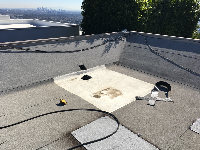 Roof area above leak in Bar with liquid applied waterproofing in failed attempt at repair.