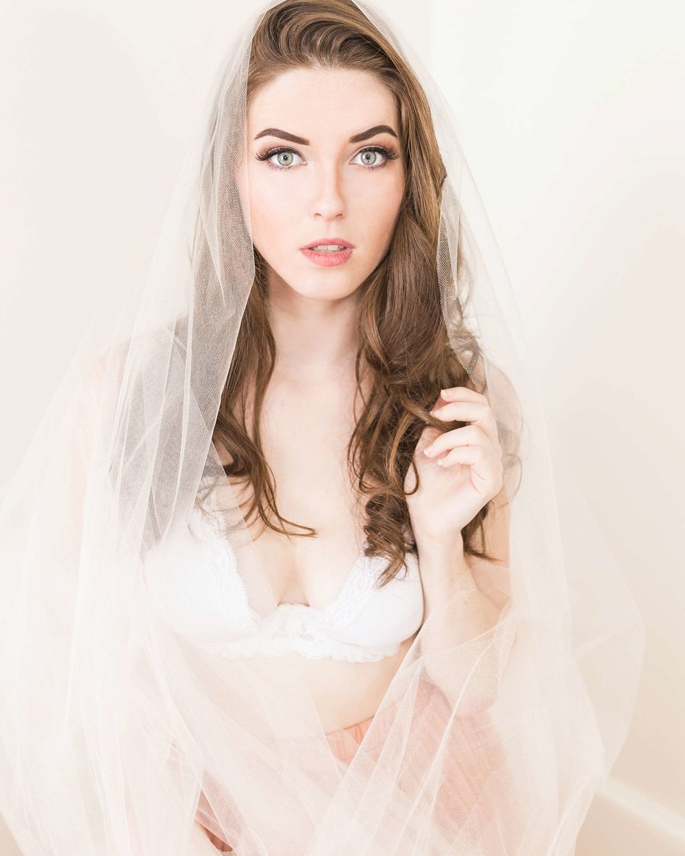 Contemporary boudoir, glamour, head shot photo shoot with an aspiring actress. Ashley looked stunning in a DIY Frida Kahlo inspired head piece, tulle skirt, gold sequin dress and white sheet.