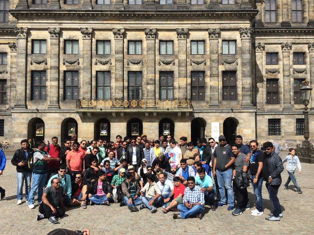 EdelweissFin group picture in front of Royal Palace on Dam Square.