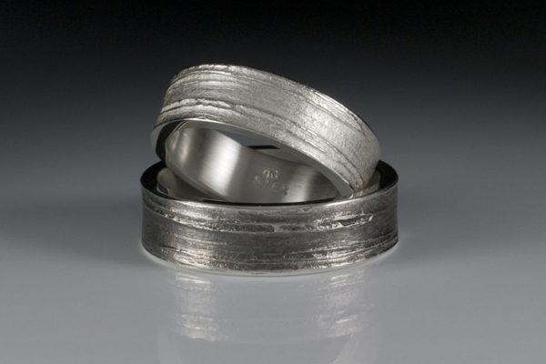 "Silver ""birch bark"" rings created using organic casting with one ring featuring a patina surface."