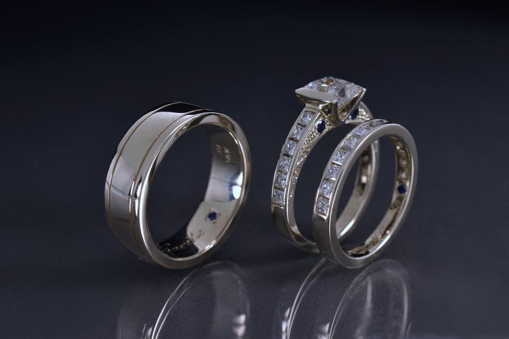 14k White Gold wedding set. Featuring Princess Cut diamonds and blue sapphires.