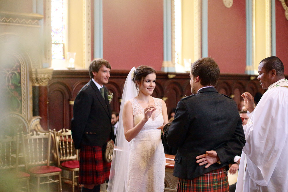 bride and groom ring exchange photo Scotland