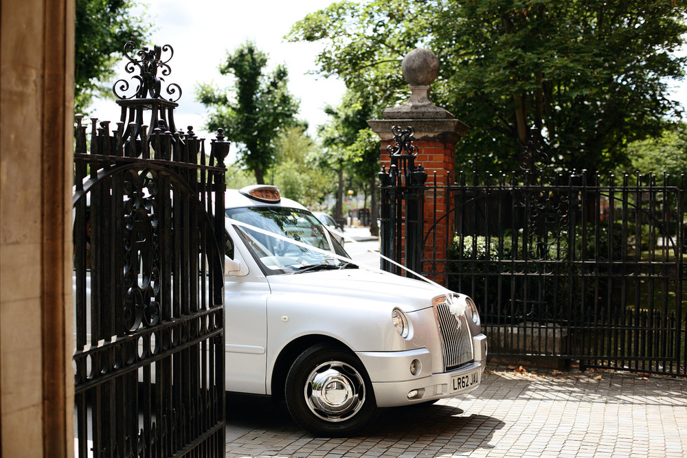 White London taxi wedding car photo