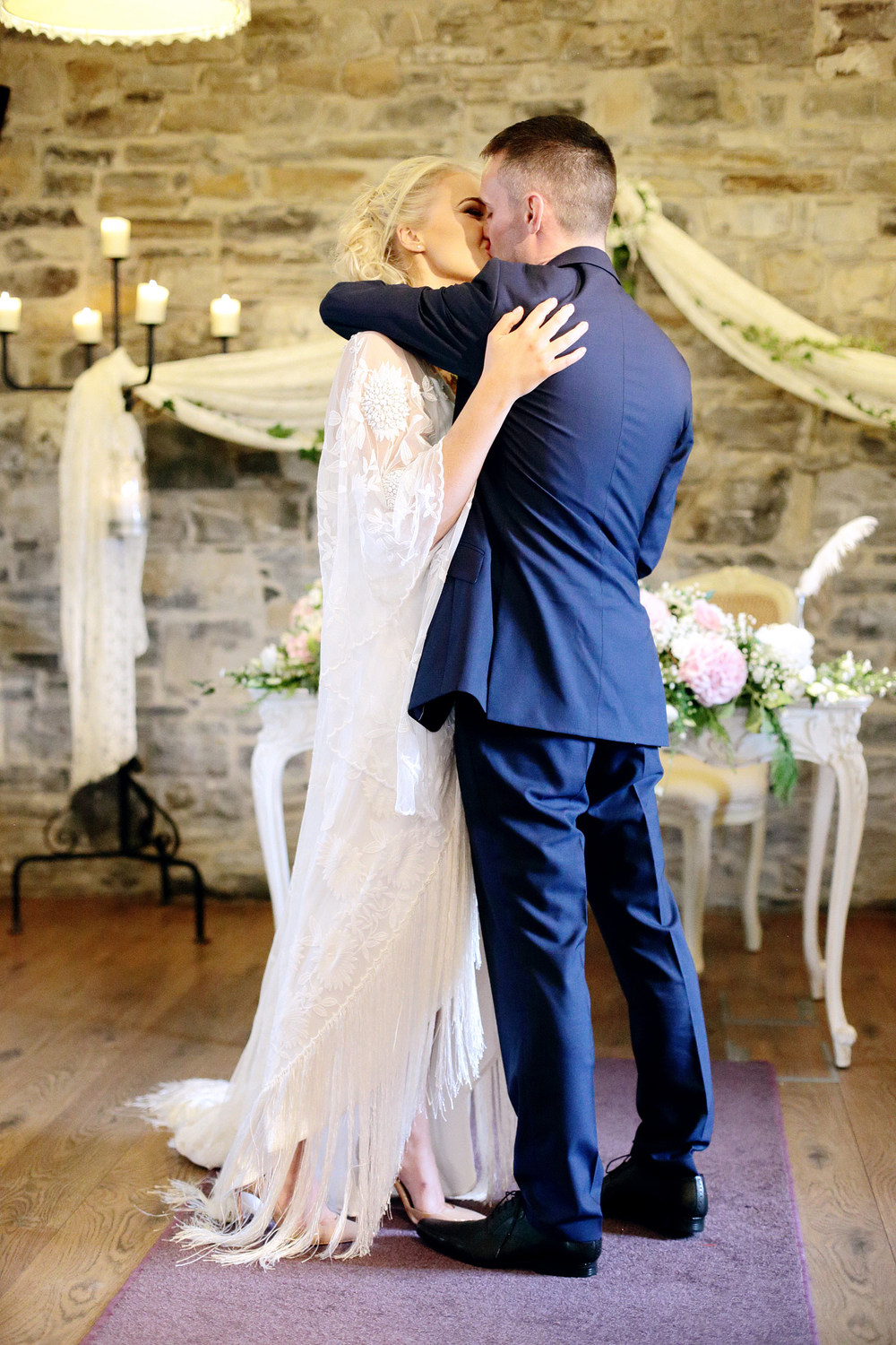 bride and groom first kiss photo Ballymagarvey Village