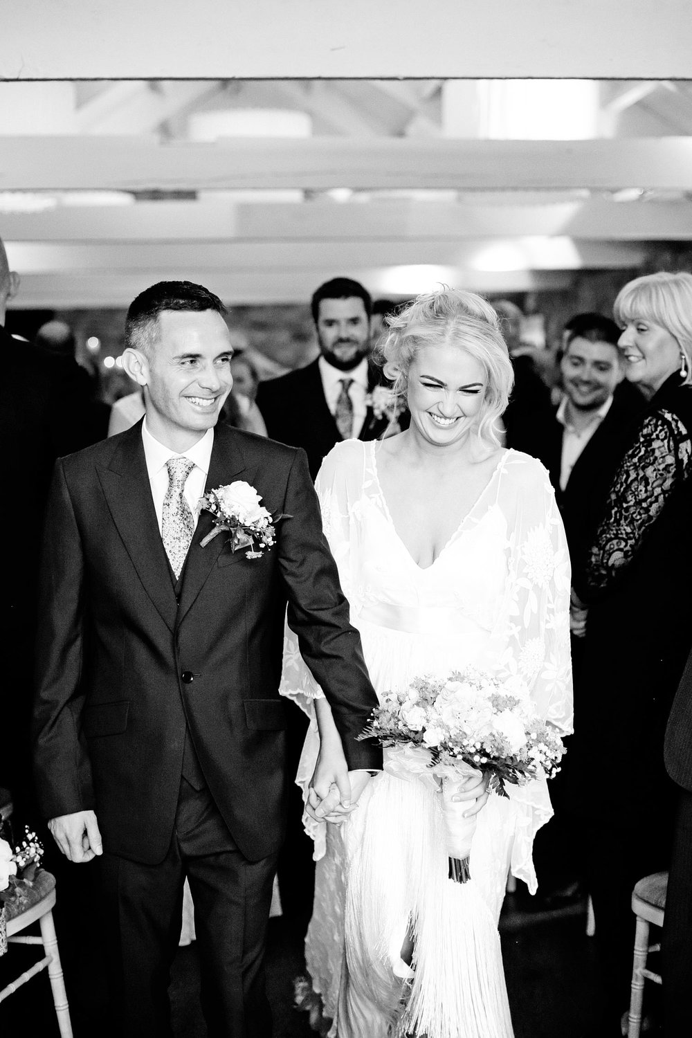 bride and groom exit photo Ballymagarvey Village Meath Ireland