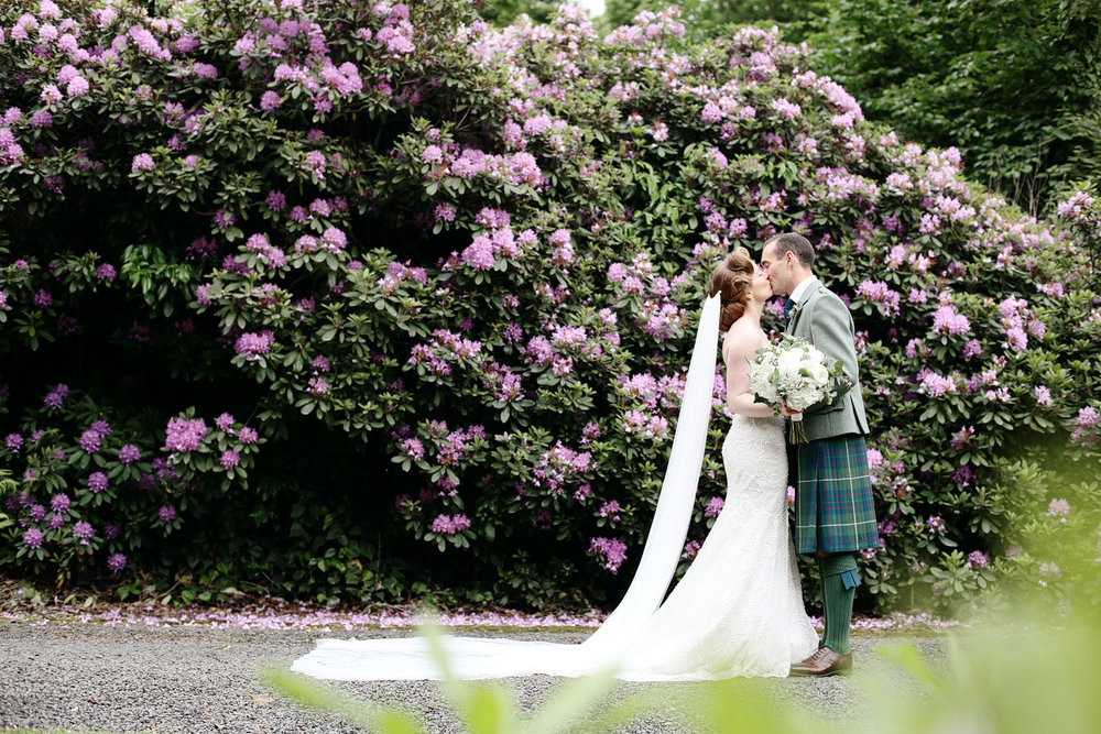 bride and groom kissing at Hillhouse Ayrshire Scotland