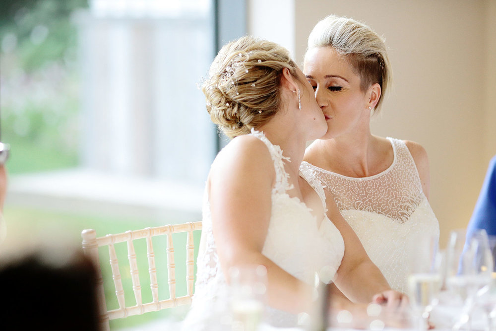 two brides kissing wedding photo