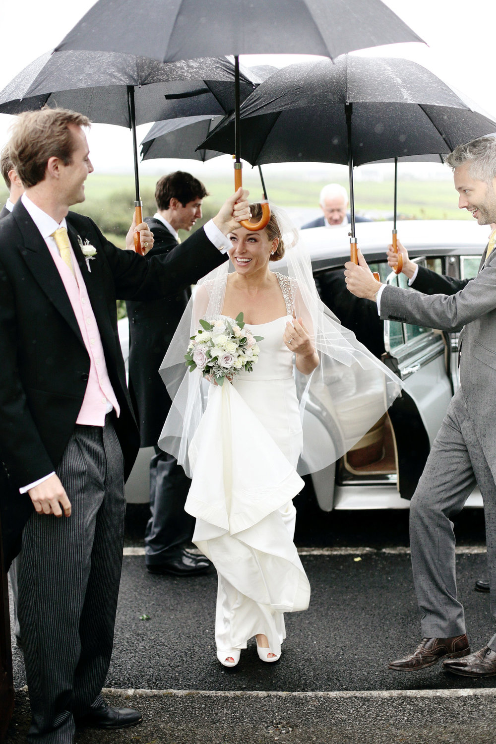 bride arriving at church at doonbeg clare ireland