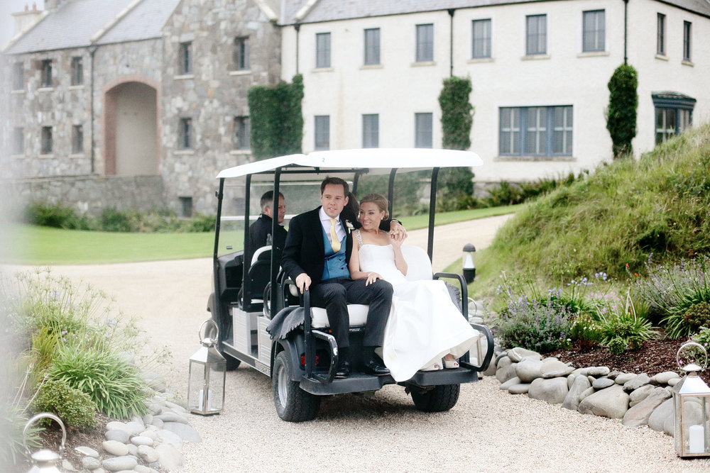 bride and groom arrive at wedding reception at doonbeg lodge