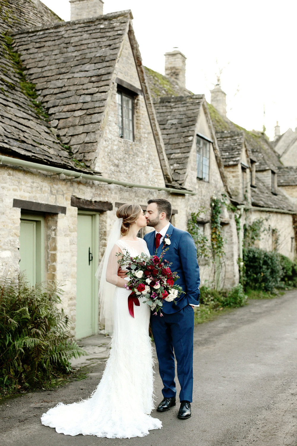 bride and groom kissing at Cripps Barn Gloucestershire