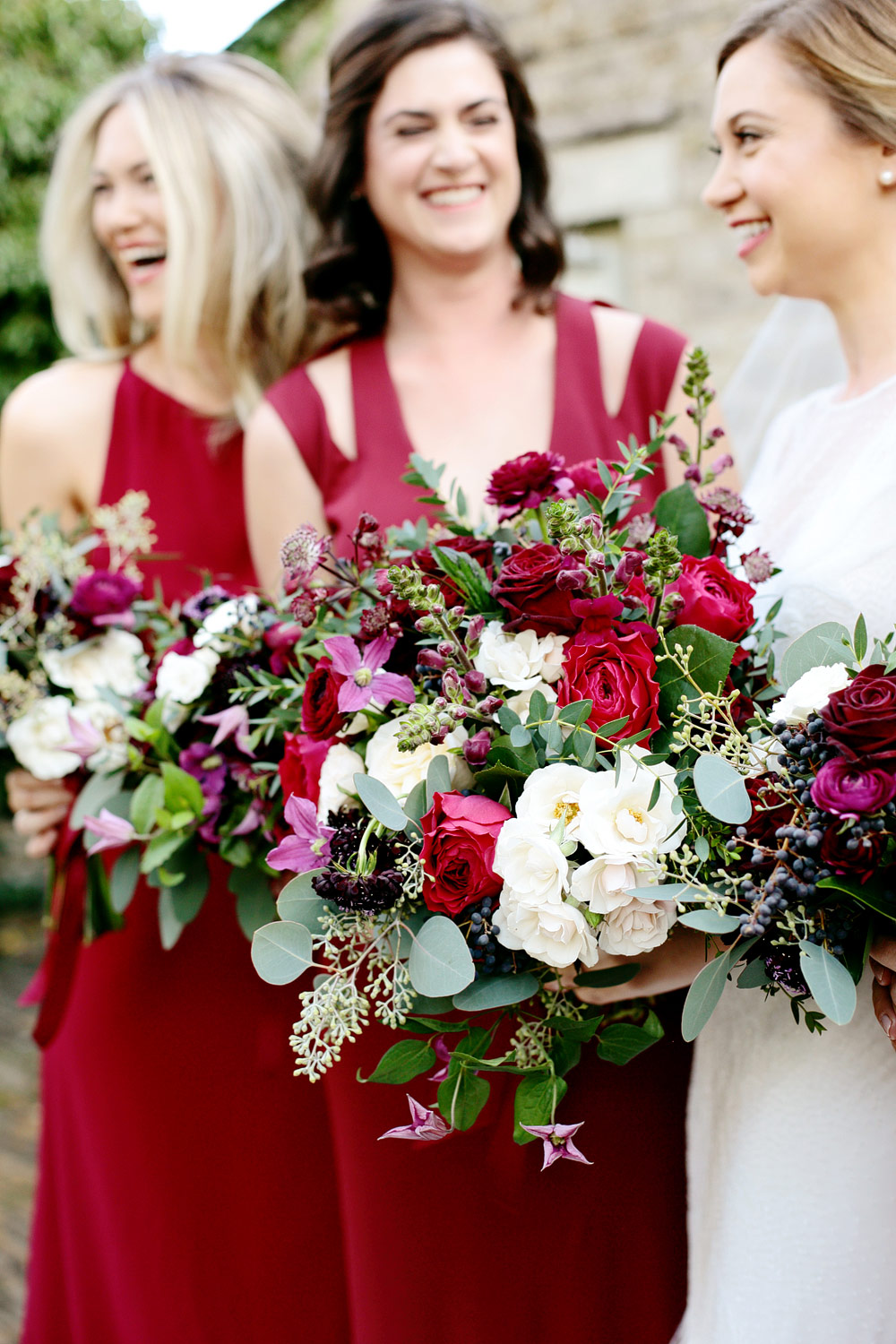 bridesmaids in red at Barnsley House photo