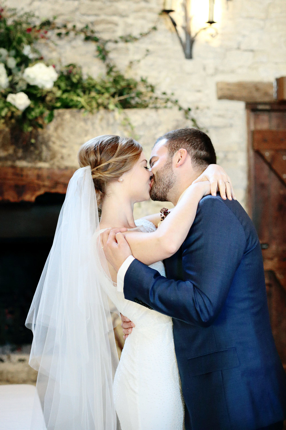 Cripps barn wedding first kiss photo