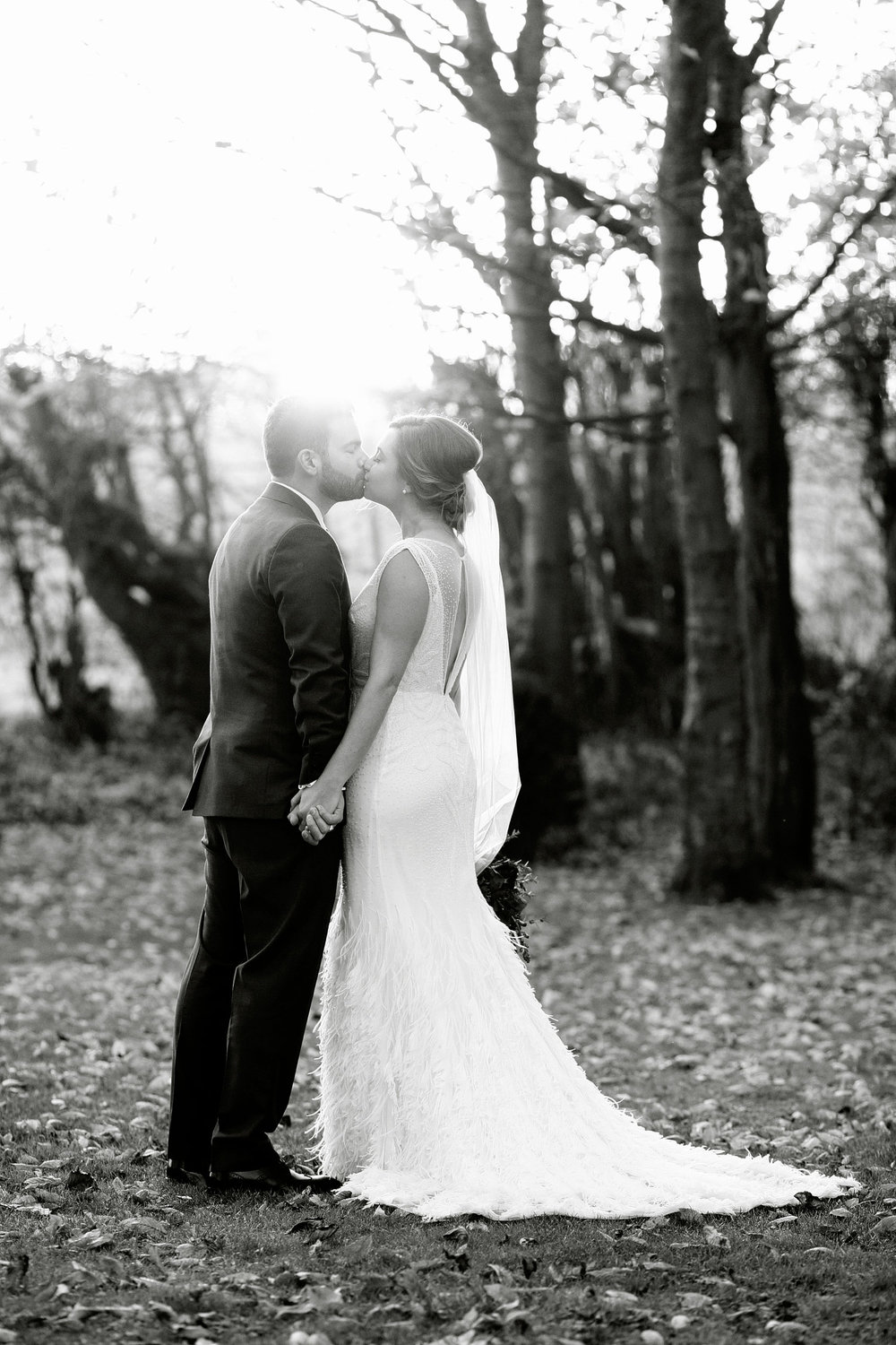 bride and groom kissing at cripps barn venue photo