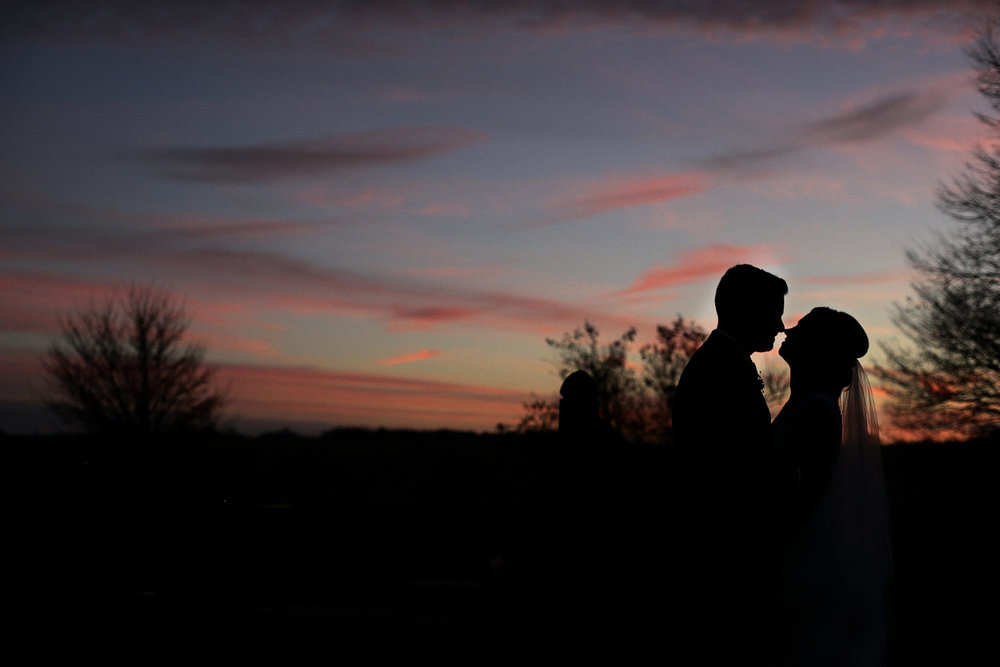 bride and groom sunset photo at Cripps barn
