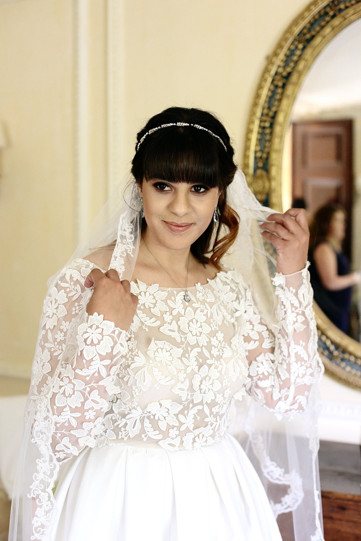 bride in rime arodaky wedding dress cliff at lyons