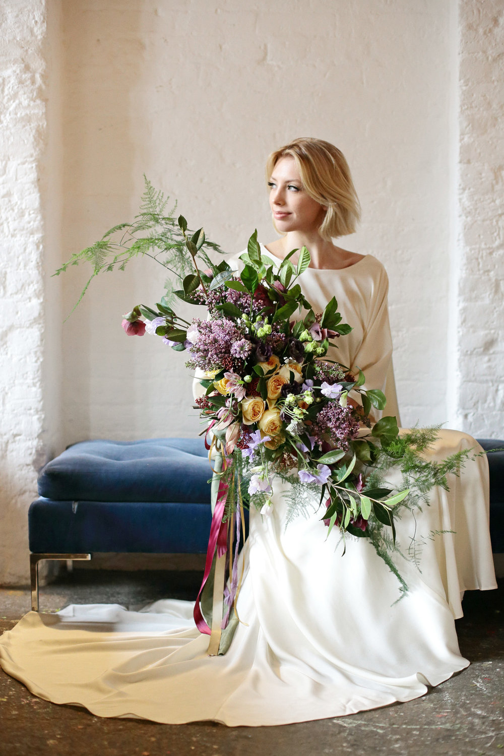 bride with spring wedding bouquet