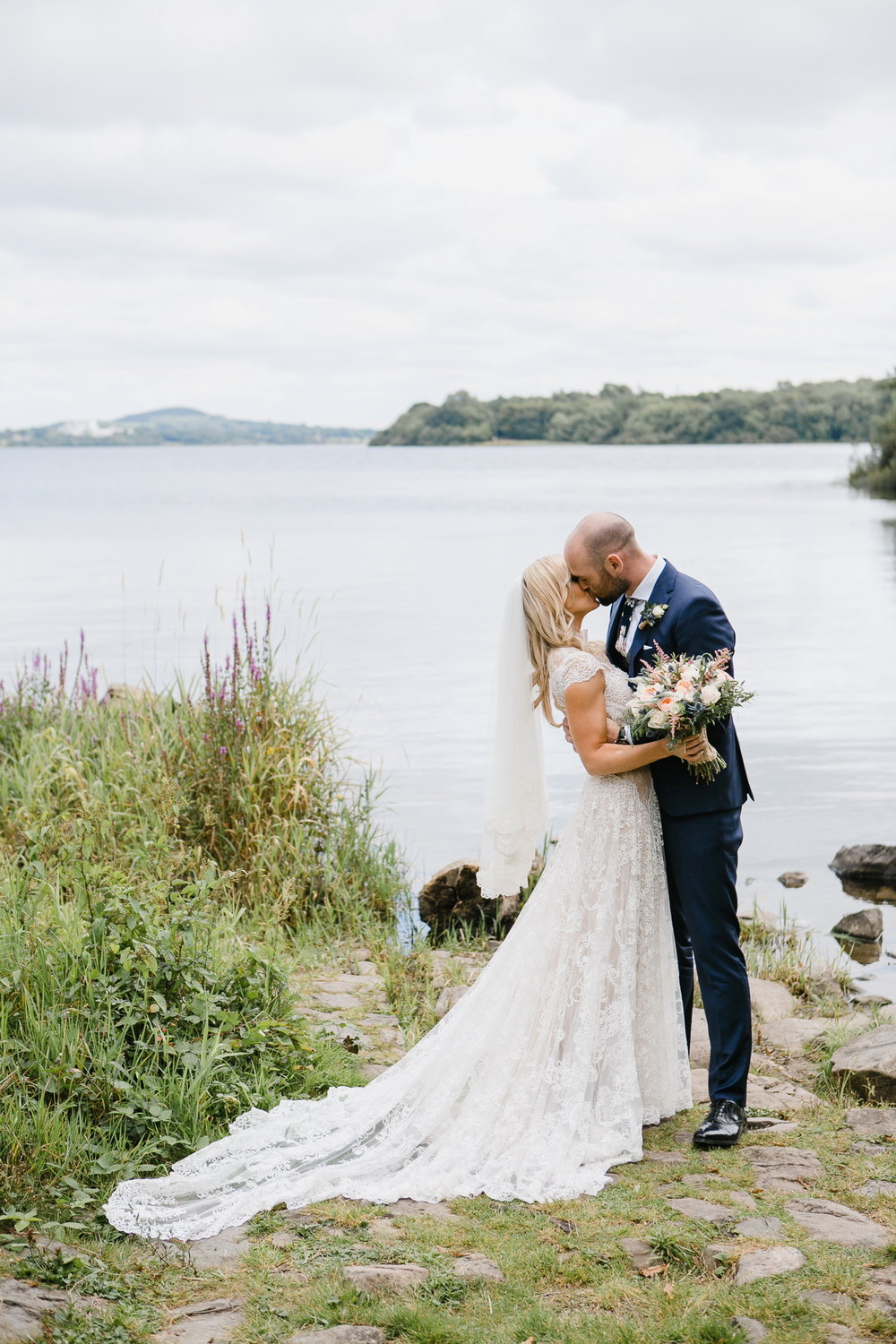 bride and groom by lough ramor at virginia park lodge