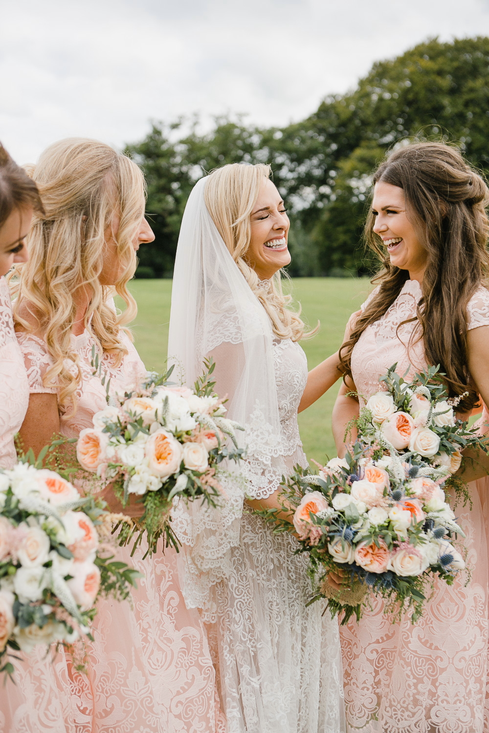 bride and bridesmaids laughing at virginia park lodge