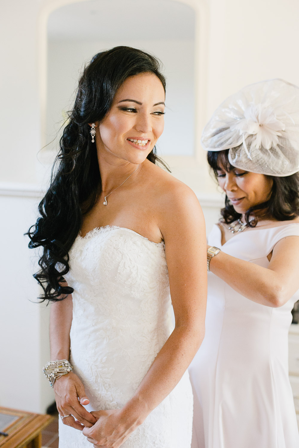 bride getting dressed at Dorney Court wedding venue