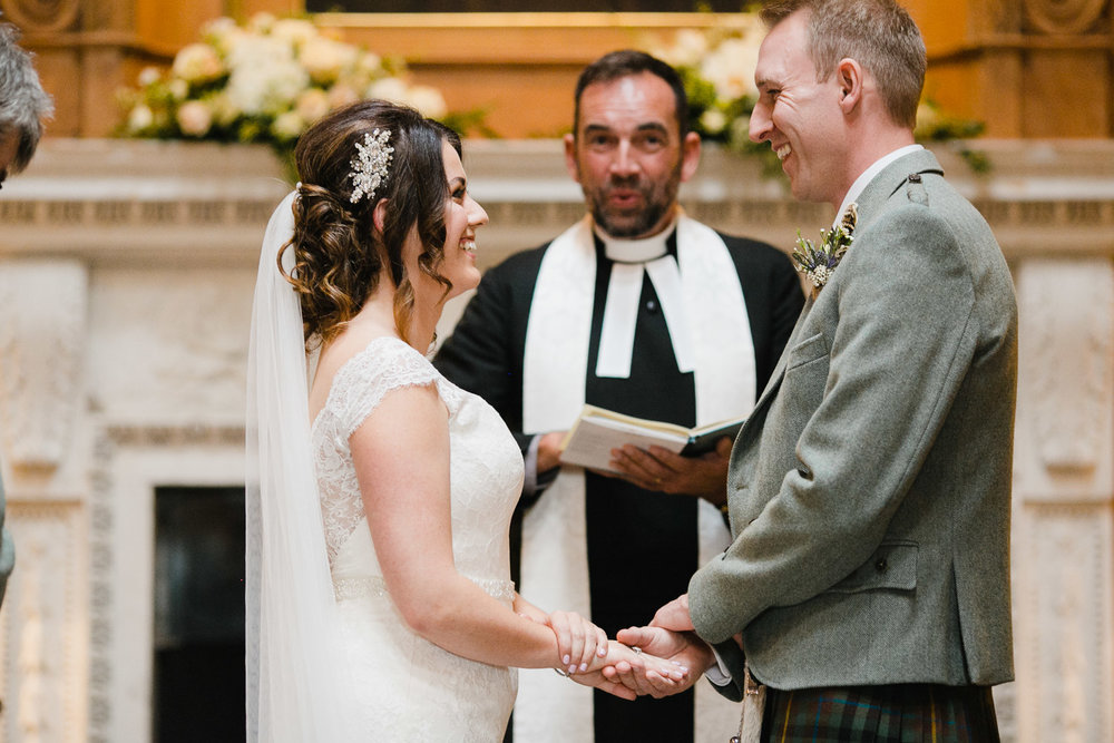 bride and groom exchange rings at Dumfries House