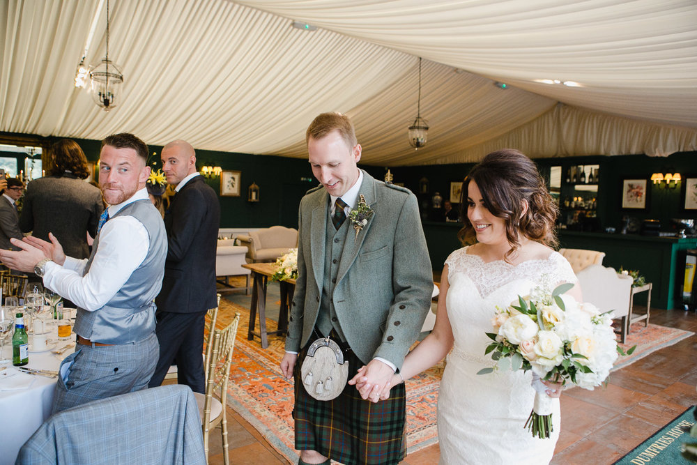 bride and groom entrance wedding reception Dumfries House