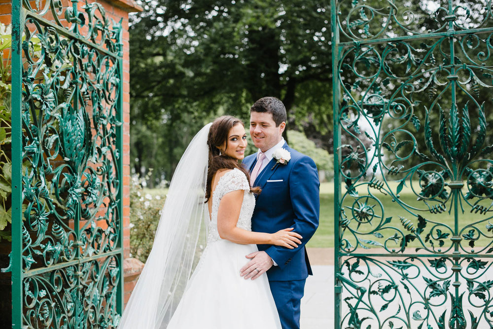 Bride And Groom Portrait In Walled Garden At Tankardstown House