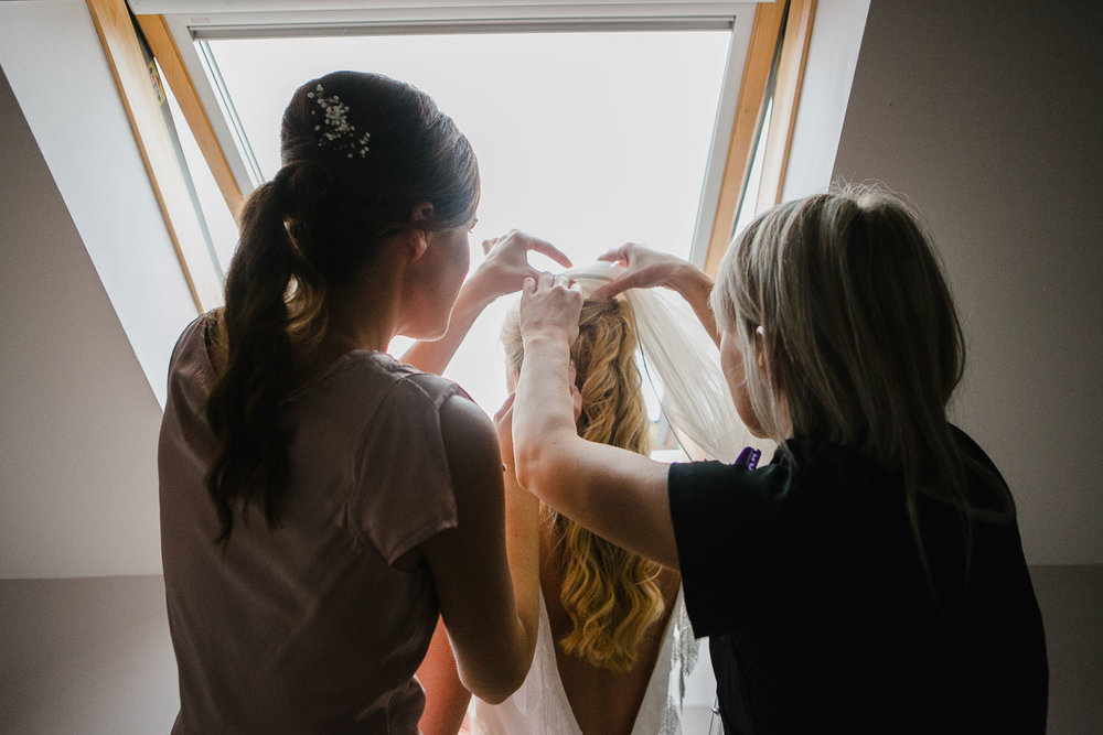 Bridesmaids Fixing Veil Photo
