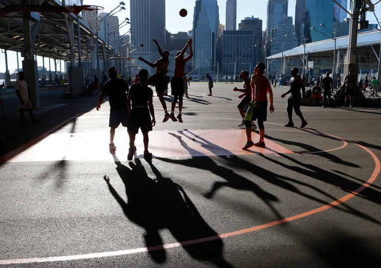 The basketball courts on Pier 2 at Brooklyn Bridge Park draw players from around the city. But a rash of courtside fights, punctuated by gunfire last year, have prompted the police, at times, to shut down the pier. CreditAlex Wroblewski for The New York Times
