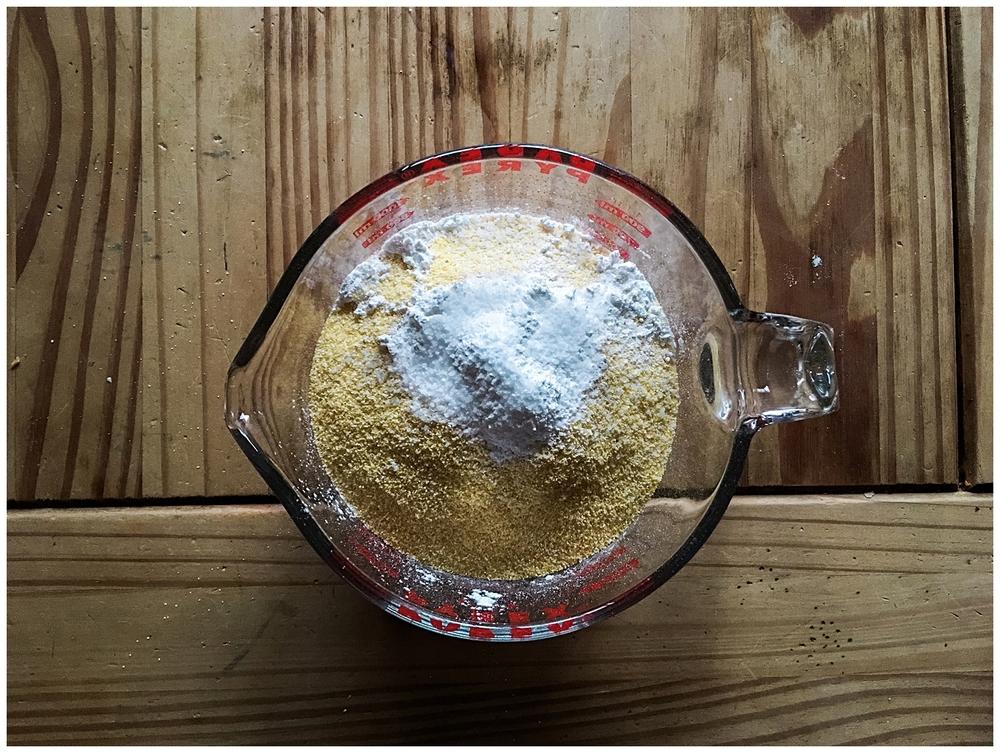 Combine flour, cornmeal, baking powder, and salt;