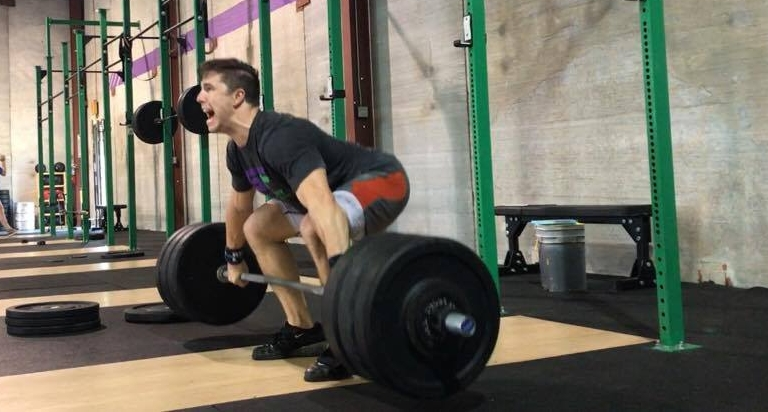 National level lifter Beaux Blackwood snatching at GeauxFit Training Caboose Barbell Club USAW in Metairie and New orleans