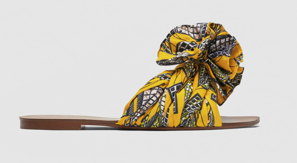 Scarf Wrap -  Everyone loves scarves so why not add them to your shoes? A popular summer sandal is the scarf wrap sandal. It is exactly what it says, a sandal that instead of plastic or any other material on the top to hold your feet in it, it is a beautiful scarf.