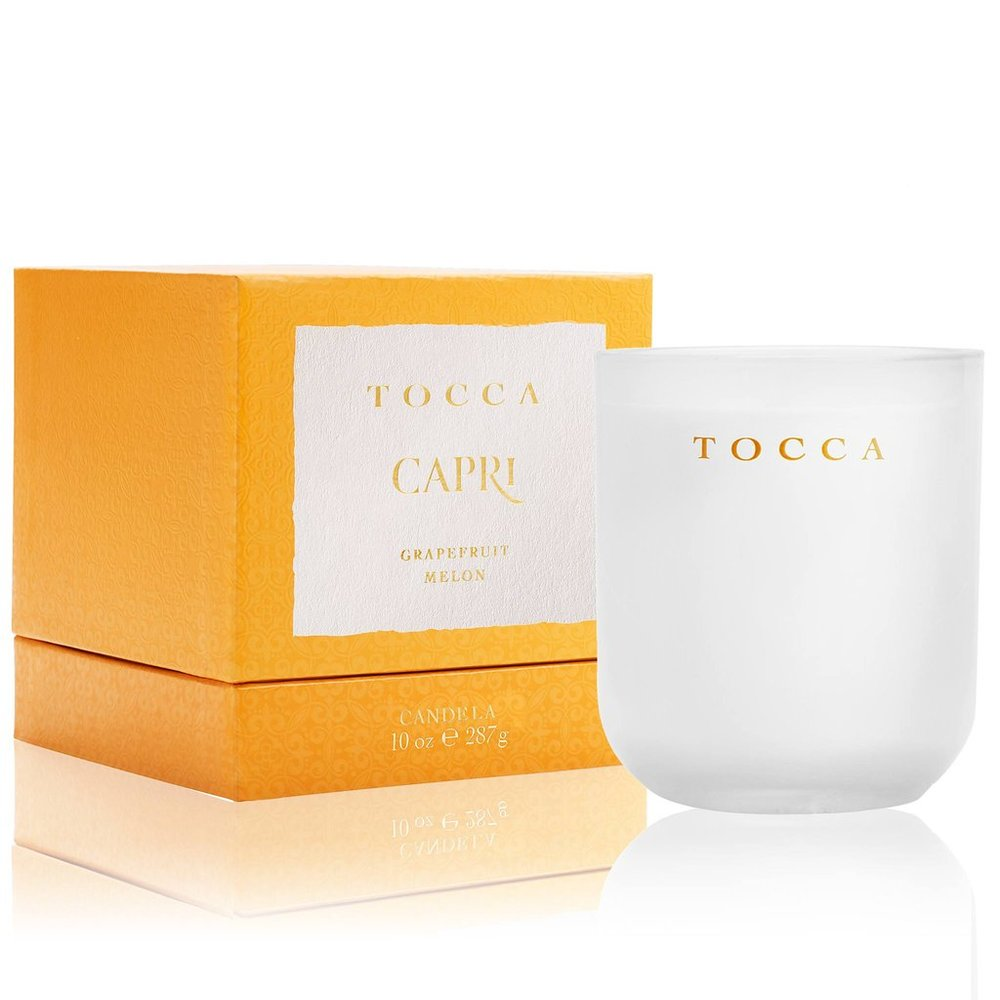 CAPRI - Designed to hint the beauty of the Capri it is a great candle if you love the idea of a stroll through grand villas, lush citrus gardens and banks of brilliantly colored bougainvillea. You will pick up the scent of grape fruit and melon. To get this candle visit tocca.com.