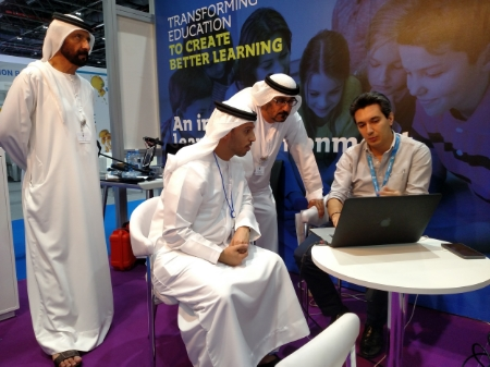 His Excellency Hussain Ibrahim Al Hammadi Minster of Education (standing) and His Excellency   Dr Ahmad Belhoul Minister of State for Higher Education Affairs   watches as CEO Babak Khosravifar demonstrates Mentorina's learning platform.