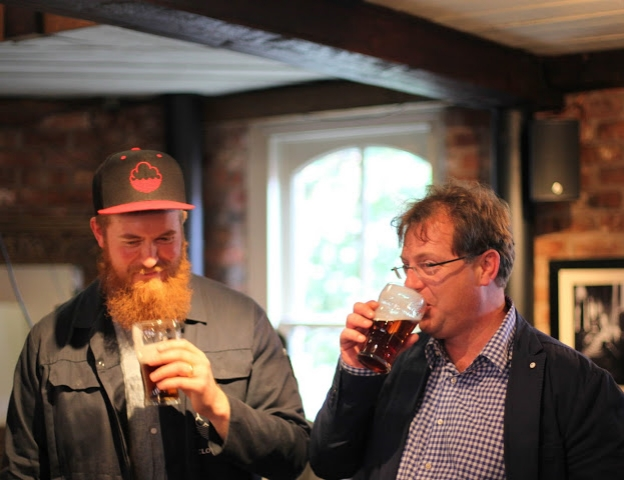 Paul Jones, co-founder of Cloudwater Brew Co,and Michael Lees-Jones, head brewer at JW Lees, share a drink.