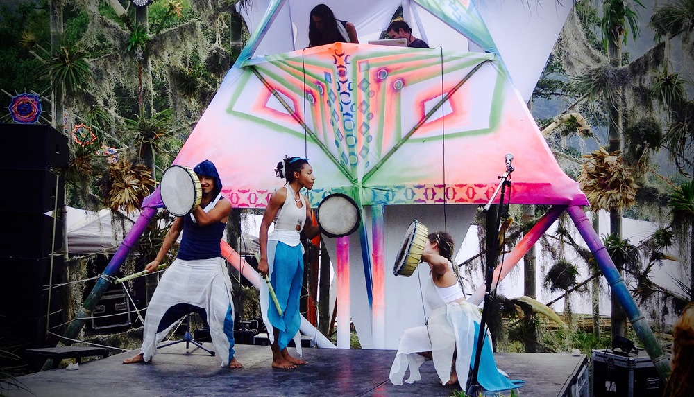 """Channelers Adrian Lobo and Bee Inspiral (left, center) preforming """"Waves; Interactive Water Medicine Dance"""" at Cosmic Convergence Festival, Dec 30 - Jan 2 2016. Selva Bhairvi and Juan Carlos Taminchi, who also shared at Open Channel Retreat,collaborated with stage design.Photo: Lily Rothrock"""