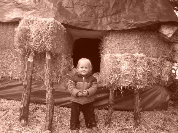 Layla's Child in front of their handbuilt straw bale home.  Photo: Layla Verbance