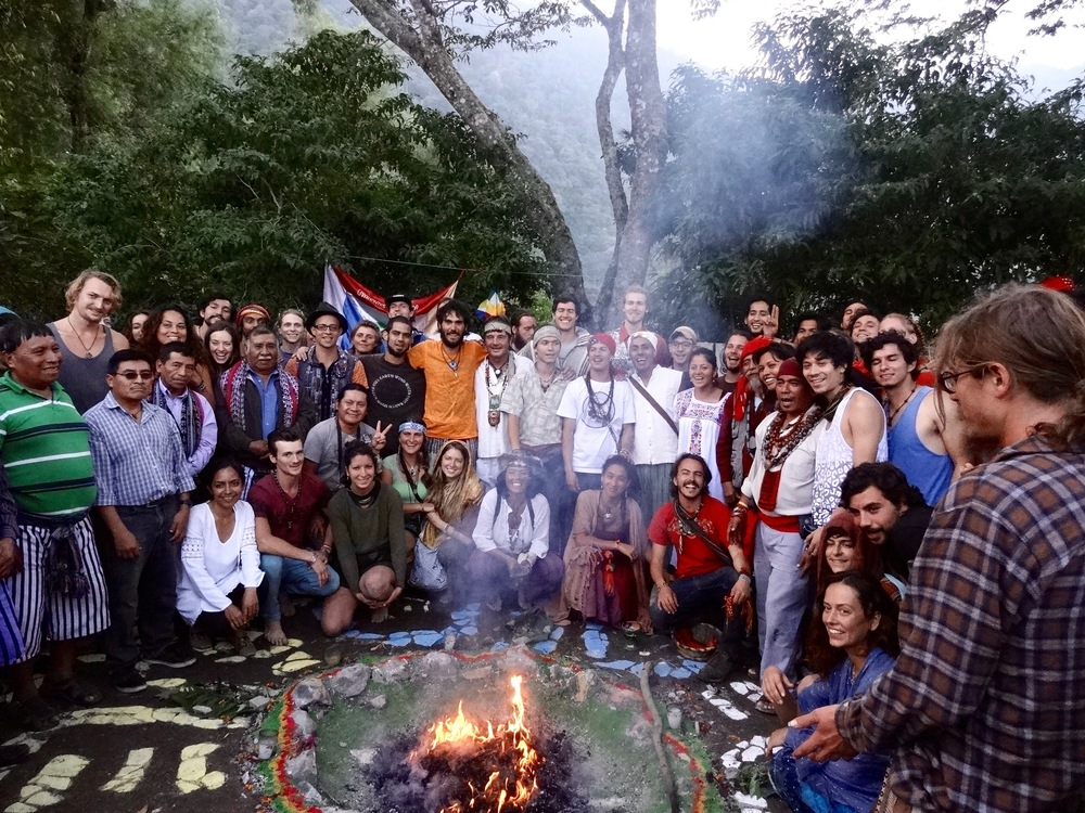 Global Family Photo at the Sacred Fire after Opening Ceremony.  Photo: Lily Rothrock