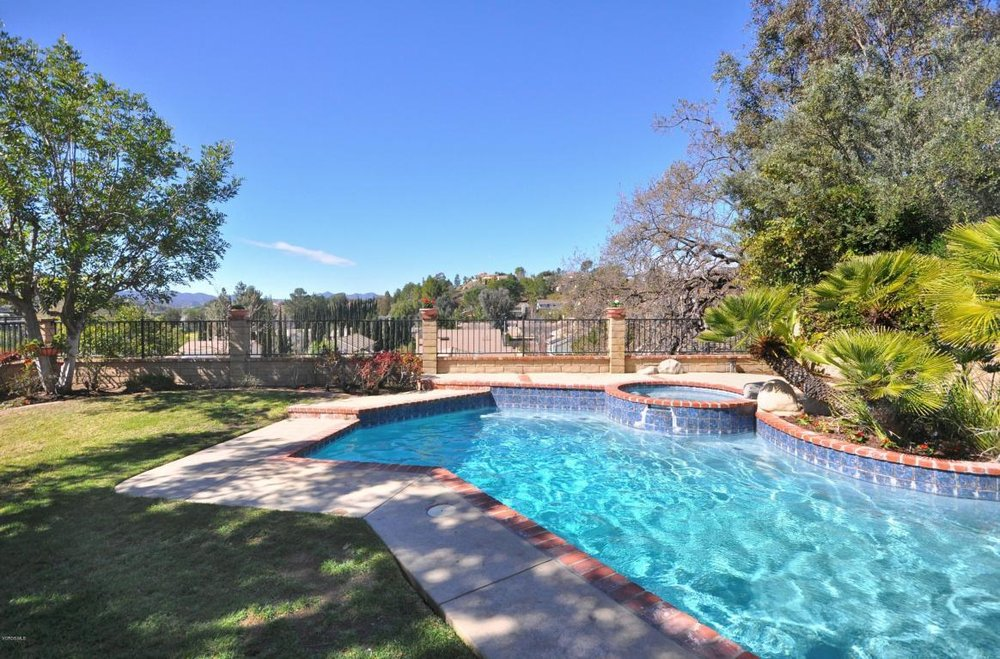 Spectacular view location on prime cul-de-sac facing a greenbelt 5533 MICAELA DRIVE, AGOURA HILLS CA 91301 $929,900    Open and airy. Recently remodeled home features granite countertops, travertine & wood style floors, recessed lighting, elegant light fixtures and dual pane windows. Soaring ceiling in living room. Formal dining room. Open kitchen with breakfast nook, travertine floors and granite countertops, along with stainless steel appliances and a garden window. Family room with stunning travertine fireplace. Master bedroom features walk-in closet, dramatic travertine fireplace, an en suite remodeled bathroom with a large soaking tub and and granite countertops. Step out onto the large, private deck overlooking the unspoiled scenic views, while you enjoy your own private resort featuring a remodeled pool & spa with grassy area and built-in BBQ with cooktop.