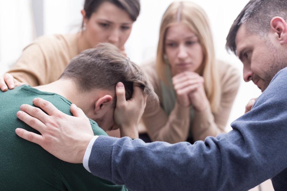 man depressed at a mental health group